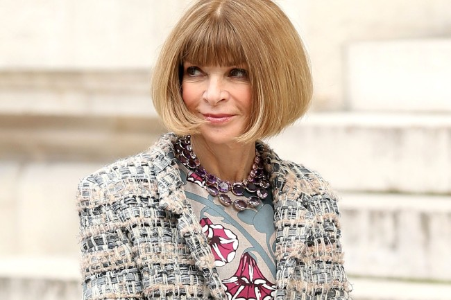Vogue Editor Anna Wintour suffers a hair malfunction when a gust of wind blows her perfectly coiffed hair into a mess as she leaves the Stella McCartney Autumn/Winter 2014-15 fashion show at Paris Opera House in Paris, France