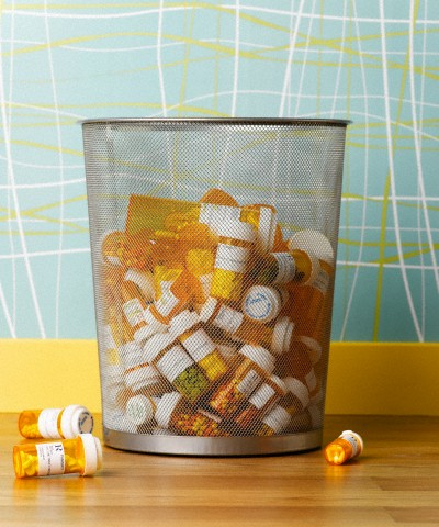 Prescription pill bottles in waste basket