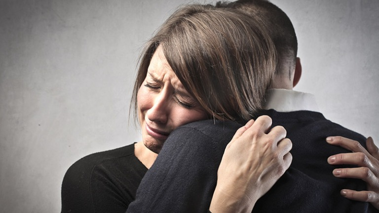 bigstock-Sad-woman-hugging-her-husband-30688547-800x450