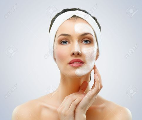 10281761-beauty-women-getting-facial-mask-Stock-Photo-face