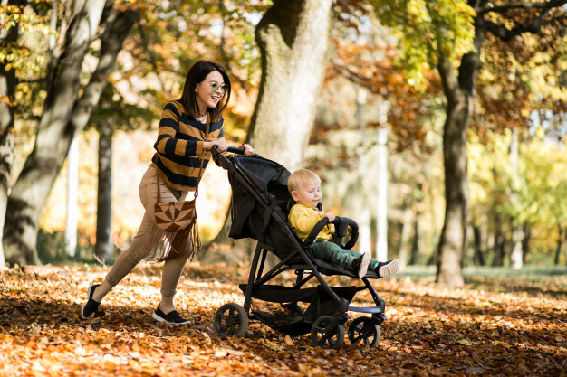 mother-and-son-in-autumn-park_1303-5464