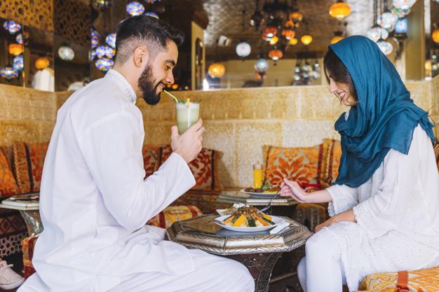 muslim-couple-eating-in-arab-restaurant_23-2147794267
