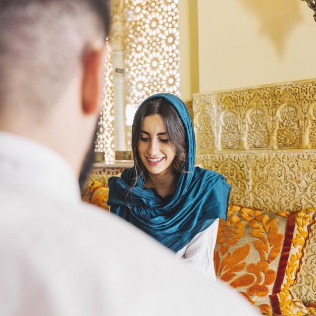 muslim-couple-in-arab-restaurant_23-2147794263