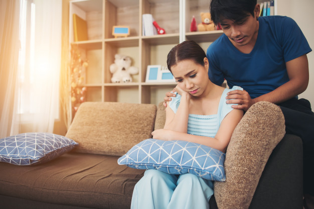 young-couple-serious-in-living-room_1150-5269